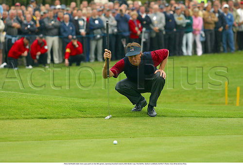 PAUL AZINGER (USA) lines up a putt on the 4th green, opening fourball match,34th Ryder Cup, The Belfry, Sutton Coldfield, 020927. Photo: Glyn Kirk/Action Plus....Golf golfer player 2002.putts putting....