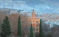 Tower of the Hotel Alhambra Palace with view over the town below and on the hillside in the distance, Granada, Andalusia, Spain. From the 8th to the 15th centuries, Granada was under muslim rule and retains a distinctive Moorish heritage. Granada was listed as a UNESCO World Heritage Site in 1984. Picture by Manuel Cohen