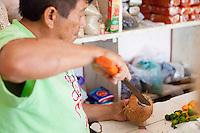 Street vendor preparing a coconut, Tulum, Mexico.<br /> <br /> Canon EOS 5D Mk II, 24-105 L lens