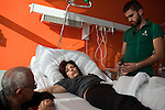 Mwafak Al Aydi speaks with his sister Manal and nephew Nowras, 19, at a hospital in Friedrichshafen, Germany, Oct. 24, 2014. Manal, very ill with cancer in her brain, abdomen, and leg, arrived from Turkey the previous day, wanting to spend whatever time she had left with her family in Germany. She collapsed when she arrived at the airport in Friedrichshafen, but the police thought she was lying about being ill. Wisam Al Aydi and his family fled their home in besieged Yarmouk Palestinian refugee camp near Damascus after it was hit by shelling last year. Since then, the family of seven has moved 11 times, including at least five times in Germany. They were preparing for a final move, to the city of Lüneberg near Hamburg, to be closer to Wisam's brother Mwafak. Around 200,000 people are expected to apply for asylum in Germany in 2014, with an ever-increasing number coming from Syria.