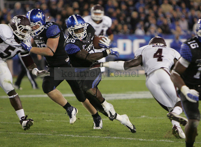 Junior tailback CoShik Williams runs the ball during the second half of UK's blackout home game against Mississippi State at Commonwealth Stadium in Lexington, Ky., on Saturday, Oct. 29, 2011. Mississippi State won 28-16. Photo by Tessa Lighty | Staff
