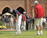 27 SEP 12 Jim Furyk works on his putting withcaddie Mike Cowan during Thursdays Practice Round at The 39th Ryder Cup at The Medinah Country Club in Medinah, Illinois.