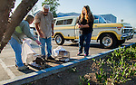 Julie Linford, Ray Zeeb, and Susan Smith prepare to return previously trapped cats that have now been spayed/neutered and vaccinated to their outside home area in Antioch, California, on Saturday, March 22, 2014.  Smith runs Rivertown Cats and volunteers for H.A.R.P., Zeeb volunteers for H.A.R.P. (Homeless Animal Response Program) and Linford runs Outcast Cat Help of Martinez.  Photo/Victoria Sheridan