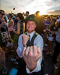 Patrick Murphy, from Bozeman, MT, dressed as a Notre Dame leprechaun as he and his friends enjoy their late afternoon party prior to the BCS National Championship at Sun Life Stadium in Miami on January 7, 2013. <br />