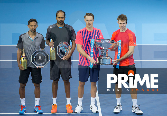 Henri Kontinen & John Peers stand as 2016 winners next to runners up Raven Klassen & Rajeev Ram during the Barclays ATP World Tour Finals FINAL match between Henri Kontinen & John Peers and Raven Klassen & Rajeev Ram at the O2, London, England on 20 November 2016. Photo by Andy Rowland.