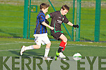 KIngdom Boy's Jack Tobin gets away from Inter Kenmare's Kaleb Lynch-Patterson in the U11's Kerry Cup at IT Tralee on Saturday.
