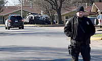 NWA Democrat-Gazette/DAVID GOTTSCHALK Members of law enforcement stage Friday, March 15, 2019 at the Applegate Apartment complex in Springdale before taking Dekota Harvey, 22, into custody around 10;30 a.m. at the apartment complex. Fayetteville police said Harvey, 22, was wanted in connection with a Thursday night shooting that left one person dead and a second hospitalized. The shooting happened in the 900 block of North Leverett Avenue, according to police. Officers were called to a report of a disturbance in the area at 9:12 p.m. An ambulance was dispatched to the area at 9:16 p.m.