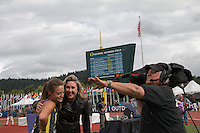 Laura Roesler is congradulated by ESPNU reporter Jill Montgomery after her victory in the 800-meters at the 2014 NCAA Division I Outdoor Track and Field Championships, Friday, June 13, in Eugene, Or.