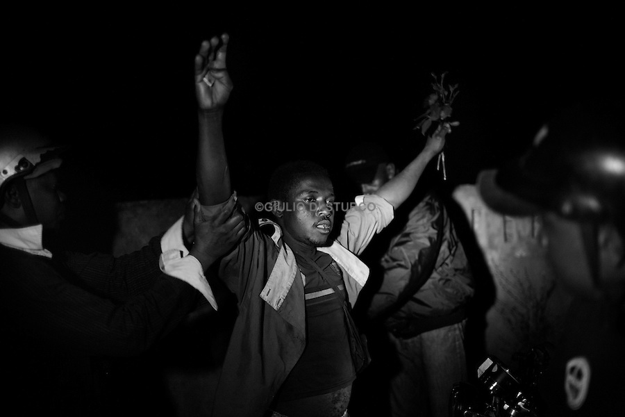 """MADAGASCAR, AMBANJA, AUGUST 2013: <br />Thief of cocoa affiliated with one of several small gangs of cocoa present in Ambanja, is arrested in the night during the patrol of the local police, 11 Aug, 2013.<br />Immediately after the murder of Radisson by the Gang of cocoa, the police launched the operation """"no mercy"""" to try to bring  legality in the valley of cocoa.<br />@Giulio Di Sturco"""