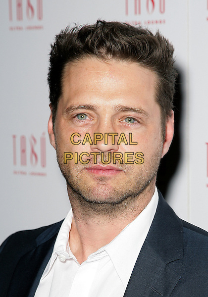 JASON PRIESTLEY.Jason Priestley celebrates his 40th birthday at Tabu Ultra Lounge inside the MGM Grand Resort Hotel and Casino, Las Vegas, Nevada, USA..August 28th, 2009.headshot portrait blue white stubble facial hair .CAP/ADM/MJT.© MJT/AdMedia/Capital Pictures.