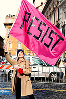 A woman waves a flag with the slogan Resist<br /> Rome January 19th 2019. Women's March Rome, march of solidarity for the civil rights and civil rights for women, organized by the American community of Rome, simultaneously with the women's march that take place worldwide on January 19th.<br /> Foto Samantha Zucchi Insidefoto