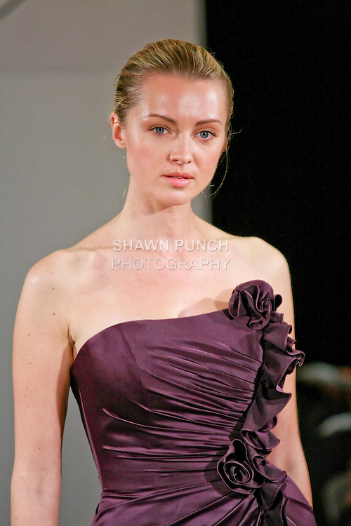 Model walks the runway in bridesmaid dress from the Simone Carvalli Spring 2011 Bridesmaid Collection, for the Simone Carvalli Spring 2011 fashion show, during the WeddingChannel Couture Show Spring 2011.