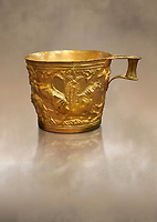 Vapheio type Mycenaean gold cup depicting a wild bull hunt side D, Vapheio Tholos Tomb, Lakonia, Greece. National Archaeological Museum of Athens. <br /> <br />  Two masterpieces of Creto - Mycenaean gold metalwork were excavated from a tholos tomb near Lakonia in Sparta in 1988. Made in the 15th century BC, the gold cups are heavily influenced by the Minoan style that was predominant in the Agean at the time. The bull hunt was popular with  Mycenaean  and Minoan artists and symolised power and fertility. The distinctive shape of the cup is kown as 'Vapheio type'.