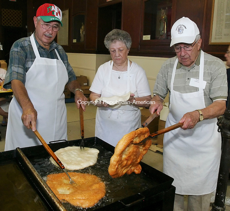 WATERBURY, CT 07/12/08- 071208BZ05- From left- Ignazio Petraroia, of Waterbury, Irene Grosso, of Waterbury, and Tony Grosso, of Waterbury, cook fried dough during the Our Lady of Mount Carmel Feast Saturday. <br />  Jamison C. Bazinet Republican-American