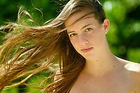 Portrait of a beautiful young woman with hair blowing in the wind