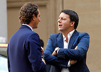 Il Presidente del Consiglio Matteo Renzi parla col presidente della Fiat John Elkann, a sinistra, durante la presentazione della nuova autovettura Jeep Renegade, a Palazzo Chigi, Roma, 25 luglio 2014.<br /> Italian Premier Matteo Renzi talks to Fiat chairman John Elkann, left, during the presentation of the new Jeep Renegade model car, at Chigi Palace, Rome, 25 July 2014.<br /> UPDATE IMAGES PRESS/Riccardo De Luca