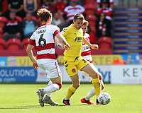 Fleetwood Town's Jordan Rossiter tries to get past Doncaster Rovers' Ben Sheaf<br /> <br /> Photographer David Shipman/CameraSport<br /> <br /> The EFL Sky Bet League One - Doncaster Rovers v Fleetwood Town - Saturday 17th August 2019  - Keepmoat Stadium - Doncaster<br /> <br /> World Copyright © 2019 CameraSport. All rights reserved. 43 Linden Ave. Countesthorpe. Leicester. England. LE8 5PG - Tel: +44 (0) 116 277 4147 - admin@camerasport.com - www.camerasport.com