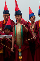Buddhist Monks playing unique Sikkimese musical instruments during the Losar New year ceremony
