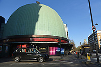 A black cab waits outside Madame Tussauds. The deserted streets show the severe effects of the COVID-19 epidemic on London on 23rd March 2020