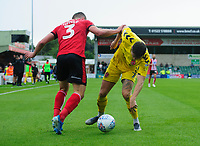 Fleetwood Town's Wes Burns vies for possession with Lincoln City's Harry Toffolo<br /> <br /> Photographer Chris Vaughan/CameraSport<br /> <br /> The EFL Sky Bet League One - Lincoln City v Fleetwood Town - Saturday 31st August 2019 - Sincil Bank - Lincoln<br /> <br /> World Copyright © 2019 CameraSport. All rights reserved. 43 Linden Ave. Countesthorpe. Leicester. England. LE8 5PG - Tel: +44 (0) 116 277 4147 - admin@camerasport.com - www.camerasport.com