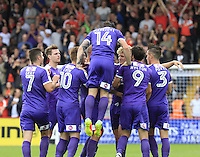 Cameron McGeehan (third right) is mobbed by team mates after scoring the opening goal during the Sky Bet League 2 match between Stevenage and Luton Town at the Lamex Stadium, Stevenage, England on 20 August 2016. Photo by Liam Smith.