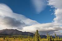 Clouds fill the sky over the Alaska Range and tundra in Denali National Park, Alaska.