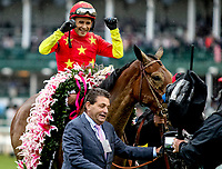 LOUISVILLE, KY - MAY 05: Mike Smith celebrates after winning the Kentucky Oaks aboard Abel Tasman #13 on Kentucky Oaks Day at Churchill Downs on May 5, 2017 in Louisville, Kentucky. (Photo by Candice Chavez/Eclipse Sportswire/Getty Images)