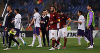 Calcio, Europa League: Ritorno degli ottavi di finale Roma vs Fiorentina. Roma, stadio Olimpico, 19 marzo 2015.<br /> Fiorentina coach Vincenzo Montella, center, congratulates with his players as Roma's Daniele De Rossi, fourth from right, and Miralem Pjanic react at the end of the Europa League round of 16 second leg football match between Roma and Fiorentina at Rome's Olympic stadium, 19 March 2015. Fiorentina won 3-0.<br /> UPDATE IMAGES PRESS/Isabella Bonotto