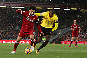 17th March 2018, Anfield, Liverpool, England; EPL Premier League football, Liverpool versus Watford; Mohammed Salah of Liverpool takes on Abdoulaye Doucoure of Watford in the build up to his third goal