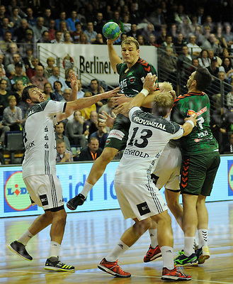 October 05-16,Max-Schmeling-Halle , Berlin,Germany<br /> Handball,F&uuml;chse Berlin vs THW Kiel<br /> Paul Drux in action,l:Domagoj Duvnjak,r:Steffen Weinhold<br /> Kiel wins 26:18