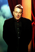 """Washington, DC - October 23, 1999 -- Robert DeNiro introduces U.S. President Bill Clinton and First Lady Hillary Rodham Clinton during the """"Concert of the Century for VH1 Save the Music"""" at the White House on October 23, 1999..Credit: Ron Sachs - Pool / CNP"""