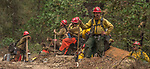 Hot shot crew takes break after early morning fire operations.<br /> After hearing the news that the South Fork Fire was 1/4 mile from Wawona, I went back to the fire to see what was happening.  Most of the fire activity last night and this morning early were near Chilnualna Falls Road.  It looked to me that the firefighters had done their jobs.   Structure protection was in place with lots of engine and hose lays all over the place.  I decided to photograph Firefighters today Monday, August 21, 2017.  Photo by Al Golub/Golub Photography.