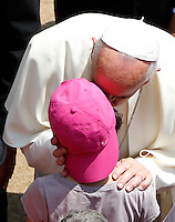 Papa Francesco saluta un bambino dopo aver recitato l'Angelus dall'ingresso della residenza estiva di Castel Gandolfo, 14  luglio 2013.<br /> Pope Francis greets a child after reciting the Angelus prayer from the entrance of his summer residence in Castel Gandolfo, on the outskirts of Rome, 14 July 2013.<br /> UPDATE IMAGES PRESS/Riccardo De Luca<br /> <br /> STRICTLY ONLY FOR EDITORIAL USE