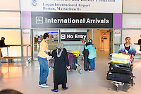 Motahhare Eslami (in green), of Urbana-Champaign, Illinois, embraces her father after her parents arrived at Logan Airport's Terminal E in Boston, Massachusetts, USA. Her parents were on a Lufthansa flight from Frankfurt, Germany, one of the first flights allowing people from seven Muslim-majority countries banned from traveling to the US under an executive order signed by President Donald Trump. Eslami's parents had planned to travel a week earlier but were prevented from traveling due to the executive order. She has a single-entry visa so could not risk a trip outside of the United States.