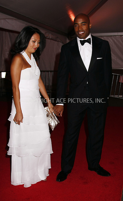 WWW.ACEPIXS.COM . . . . .....May 5, 2008. New York City.....Sports broadcaster Tiki Barber (R) and wife Ginny Cha leaving the 'Superheroes: Fashion and Fantasy' Costume Institute Gala at The Metropolitan Museum of Art...  ....Please byline: AJ SOKALNER - ACEPIXS.COM.... *** ***..Ace Pictures, Inc:  ..Philip Vaughan (646) 769 0430..e-mail: info@acepixs.com..web: http://www.acepixs.com
