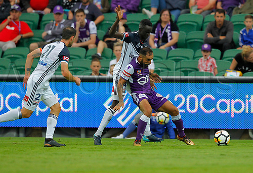 25th March 2018, nib Stadium, Perth, Australia; A League football, Perth Glory versus Melbourne Victory; Diego Castro of the Perth Glory is held off the ball by Thomas Deng of Melbourne Victory as Carl Valeri closes in