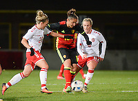 20161128 - TUBIZE ,  BELGIUM : Belgian Sara Yuceil (M) with Danish Nanna Christiansen (L) and Julie Trustup Jensen (R)  pictured during the female soccer game between the Belgian Red Flames and Denmark , a friendly game before the European Championship in The Netherlands 2017  , Monday 28 th November 2016 at Stade Leburton in Tubize , Belgium. PHOTO SPORTPIX.BE | DIRK VUYLSTEKE