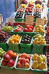 Fruits for sale in market, Montreal, Quebec, Canada, pears, peaches, plums, nectarines, grapes, cherries, French, signs, price, vertical,