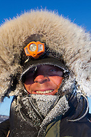 Lachlan Clarke is bundled up againts the 20 below zero cold at the ghost-town checkpoint of Iditarod  on Friday morning during the 2011 Iditarod race.