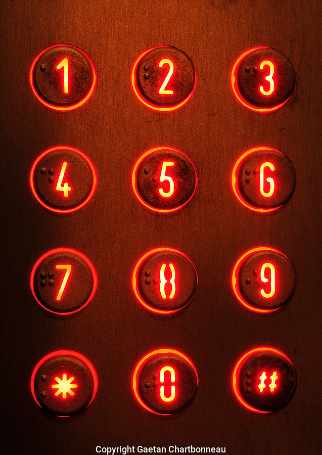 Extreme close up of a building intercom illuminated at night. Montreal, Quebec, Canada.