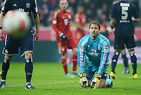 FUSSBALL   1. BUNDESLIGA  SAISON 2012/2013   27. Spieltag   FC Bayern Muenchen - Hamburger SV    30.03.2013 Enttaeuschung; Torwart Rene Adler (Hamburger SV) am Boden