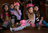 From left, Moon Anderson, Phoenix, 8, unknown girl, Lola Strauss, 8, Tempe (unicorn helmet), Khloe Parrott, 4, Phoenix, and Daisey Crawford, 9, Glendale participate in Skate Rising for Girls 91 West Skatepark in Peoria.