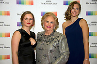 Jacqueline Mars, center, and her granddaughters, Graysen Airth, left, and Katherine Burgstahler, right, arrive for the formal Artist's Dinner honoring the recipients of the 40th Annual Kennedy Center Honors hosted by United States Secretary of State Rex Tillerson at the US Department of State in Washington, D.C. on Saturday, December 2, 2017. The 2017 honorees are: American dancer and choreographer Carmen de Lavallade; Cuban American singer-songwriter and actress Gloria Estefan; American hip hop artist and entertainment icon LL COOL J; American television writer and producer Norman Lear; and American musician and record producer Lionel Richie. Photo Credit: Ron Sachs/CNP/AdMedia