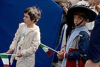 Roma, 2 Giugno 2016<br /> Bambino con cappello da bersagliere e bandiera tricolore.<br /> Celebrazioni e parata militare per il 70°anniversario della Repubblica italiana.<br /> Rome, June 2, 2016<br /> Child with hat bersagliere and tricolor flag.<br /> Celebration and military parade for the 70th anniversary of the Italian Republic