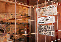 Old signs on a wall inside the assay building at Cerro Gordo, a late 19th century mining community in the Inyo Mountains near Keeler, California
