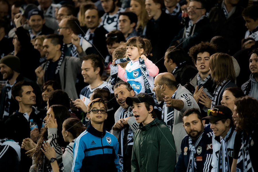 A young Victory fan in the crowd at the semi final match between Melbourne Victory and Melbourne City in the Australian Hyundai A-League 2015 season at Etihad Stadium, Melbourne, Australia.<br />