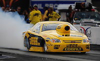 Oct. 31, 2008; Las Vegas, NV, USA: NHRA pro stock driver Jeg Coughlin Jr does a burnout during qualifying for the Las Vegas Nationals at The Strip in Las Vegas. Mandatory Credit: Mark J. Rebilas-