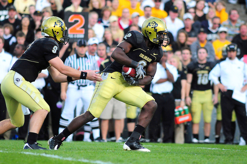18 October 08: Colorado running back Darrell Scott (2) takes a hand off from quarterback Tyler Hansen (9) during a game against Kansas State. The Colorado Buffaloes defeated the Kansas State Wildcats 14-13 at Folsom Field in Boulder, Colorado.