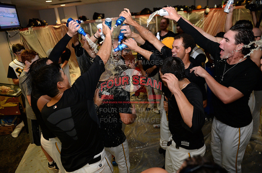 Jacksonville Suns Players celebrate in the locker room pouring beer over coach Rich Arena after clinching the Southern League Championship Series against the Chattanooga Lookouts on September 12, 2014 at Bragan Field in Jacksonville, Florida.  Jacksonville defeated Chattanooga 6-1 to sweep three games to none.  (Mike Janes/Four Seam Images)