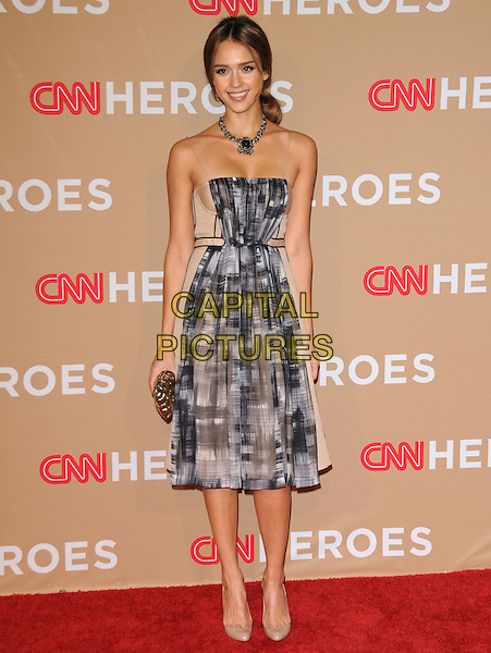 JESSICA ALBA .at The CNN Heroes: An All-star Tribute held at The Shrine Auditorium in Los Angeles, California, USA, .November 20th, 2010..full length dress beige necklace silver grey gray print smiling ponytail hair up white clutch bag nude shoes .CAP/RKE/DVS.©DVS/RockinExposures/Capital Pictures.